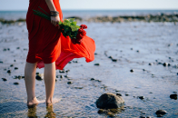 Red dress bare feet in water
