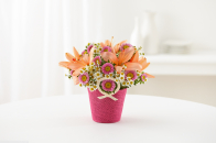 Asiatic lilies bouquet in a vase