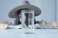 Girl seen through a glass of water