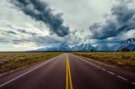 4k road field horizon mountains clouds sky