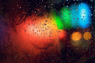 Colorful water drops on window abstract background wallpaper