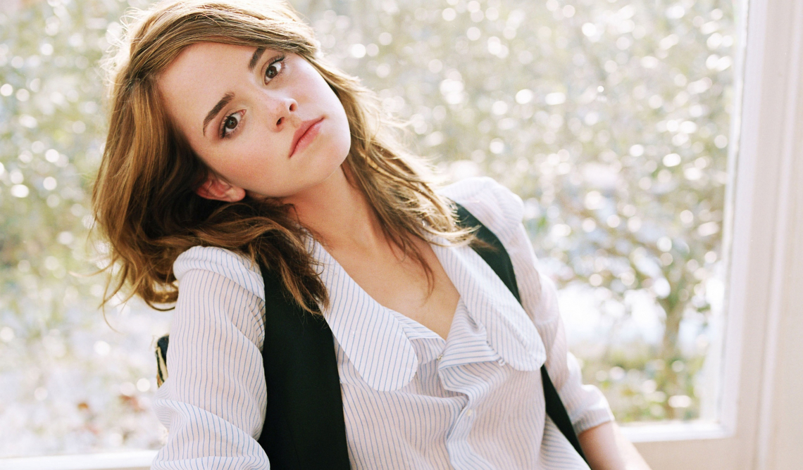 Emma watson on a chair