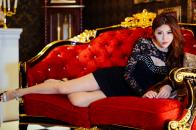 Beautiful asian woman red luxury sofa